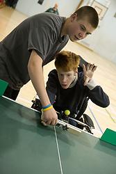 Boy in a wheelchair playing Polybat,