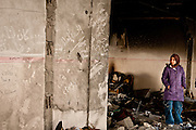 A young girl looks at the wreckage of her family's home in Gaza City.