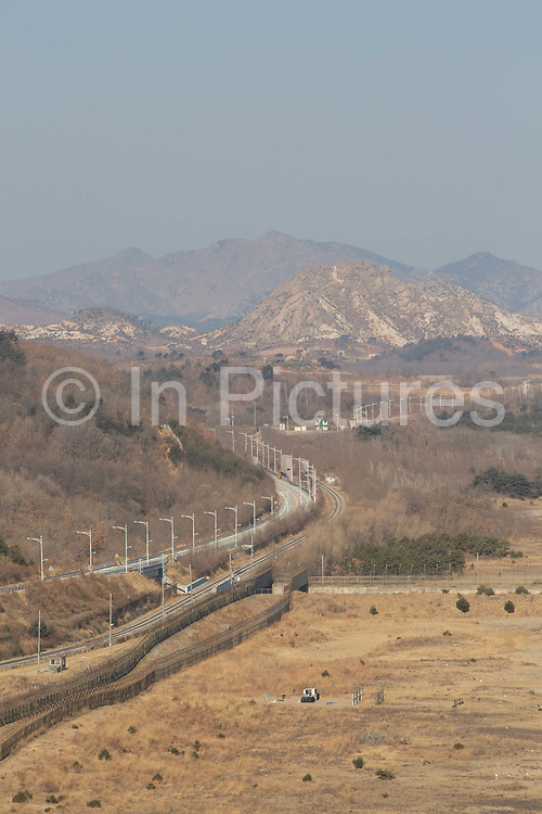 Views into North Korea and the DMZ Demilitarised Zone from the Goseong Unification Observatory on 06th February 2016 in South Korea. Open specially for the 2018 Winter Olympic and Paralympics, the site is also known as the Geumgangsan Observatory, and is a military area normally restricted to the public. Views stretch into North Korea overlooking the Geumgangsan Mountains and the Korean Demilitarised Zone, a strip of land running across the Korean Peninsula deciding the two nations. The Path to Peace tour was organised by PyeongChang and The Ministry of Culture, Sports and Tourism.