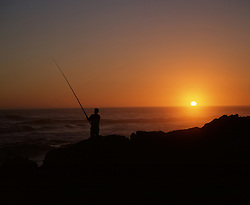 June 7, 2015 - Angler at coast an sunset, Oyster Bay, Eastern Cape, South Africa (Credit Image: © R. Philips/DPA/ZUMA Wire)
