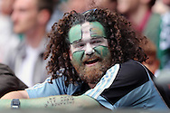 Plymouth Argyle fan in Devon flag face paint looks on during the 1st half. Skybet football league two play off final match, AFC Wimbledon v Plymouth Argyle at Wembley Stadium in London on Monday 30th May 2016.<br /> pic by John Patrick Fletcher, Andrew Orchard sports photography.