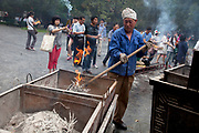 "Worker clears the burnt ashes from thousands of incense sticks which are burned at Yonghe Temple, also known as the ""Palace of Peace and Harmony Lama Temple"", the ""Yonghe Lamasery"", or - popularly - the ""Lama Temple"" is a temple and monastery of the Geluk School of Tibetan Buddhism located in the northeastern part of Beijing, China. It is one of the largest and most important Tibetan Buddhist monasteries in the world. The building and the artworks of the temple is a combination of Han Chinese and Tibetan styles."