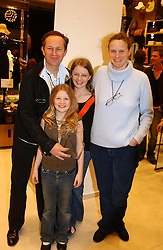 NICK & ARI ASHLEY with their children EDIE (front) and LILY (back) at a party to celebrate the opening of the new H&M Flagship Store at 17-21 Brompton Road, London SW3 on 23rd March 2005.<br /><br />NON EXCLUSIVE - WORLD RIGHTS
