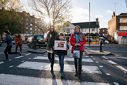 """© Licensed to London News Pictures. 25/11/2017. London, UK. Rebecca Ratcliffe (R), Martin Rollier (C) and Charlotte Samuel (L) deliver a """"Mothers Open Letter"""" to His Excellency Sayyed Ali Hosseini Khamenein at the Islamic Centre England calling for the immediate release of British Iranian Nazanin Zaghari-Ratcliffe who remains in prison in Iran. Photo credit: Rob Pinney/LNP"""