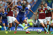 George Boyd of Burnley (l) tackles Diego Costa of Chelsea. Premier league match, Chelsea v Burnley at Stamford Bridge in London on Saturday 27th August 2016.<br /> pic by John Patrick Fletcher, Andrew Orchard sports photography.