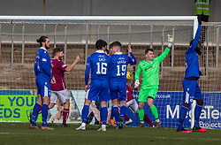 06MAR21 Arbroath's Jack Hamilton (hidden) scoring their first goal. half time : Arbroath 2 v 3 Queen of the South, Scottish Championship played 6/3/2021 at Arbroath's home ground, Gayfield Park.
