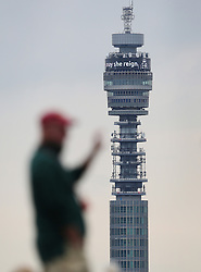 © Licensed to London News Pictures. 09/09/2015.  London, UK. A man standing on Primrose Hill looks on as The BT Tower carries a message for Queen Elizabeth II  'Long May She Reign'. Today Queen Elizabeth II becomes the United Kingdom's longest serving monarch as he passes Queen Victoria's 23,226 days on the throne.  Photo credit: Peter Macdiarmid/LNP