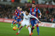 Alberto Paloschi of Swansea city shields the ball from Damien Delaney of Crystal Palace (r). Barclays Premier league match, Swansea city v Crystal Palace at the Liberty Stadium in Swansea, South Wales on Saturday 6th February 2016.<br /> pic by Andrew Orchard, Andrew Orchard sports photography.
