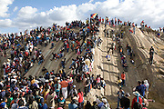 "Playing on the rocks below the Inca flag at Sacsayhuamán the Inca ruins after watching Inti Raymi. Inti Raymi ""Festival of the Sun"", Sacsayhuamán, Cusco, Peru."