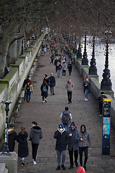 © Licensed to London News Pictures.20/12/2020, London, UK. Londoners are seen walking by the river Thames in Westminster. London enters Tier 4 severe restrictions as new Mutant Covid-19 strain is found. The new variant of the virus has been found to be 70% more infectious and is currently rampant throughout London and the South East of England. Photo credit: Marcin Nowak/LNP