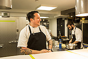 New York, NY, - December 8, 2013. Chef Matt Lambert in a light moment in the kitchen. Lambert and his wife Barbara Lambert are co-owners of The Musket Room, 265 Elizabeth St.