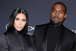 File photo dated January 24, 2015 of Kim Kardashian and Kanye West attend BET Honors red carpet at the Warner Theatre in Washington, DC, USA. US rapper Kanye West took to Twitter over the weekend to announce he was running for president, with his declaration quickly going viral and prompting a flurry of speculation. His wife Kim Kardashian West and entrepreneur Elon Musk endorsed him. Photo by Olivier Douliery/ABACAPRESS.COM