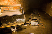 Military vehicle and stretch of tunnelling track, German Underground Military hospital, Guernsey, Channel Islands, UK