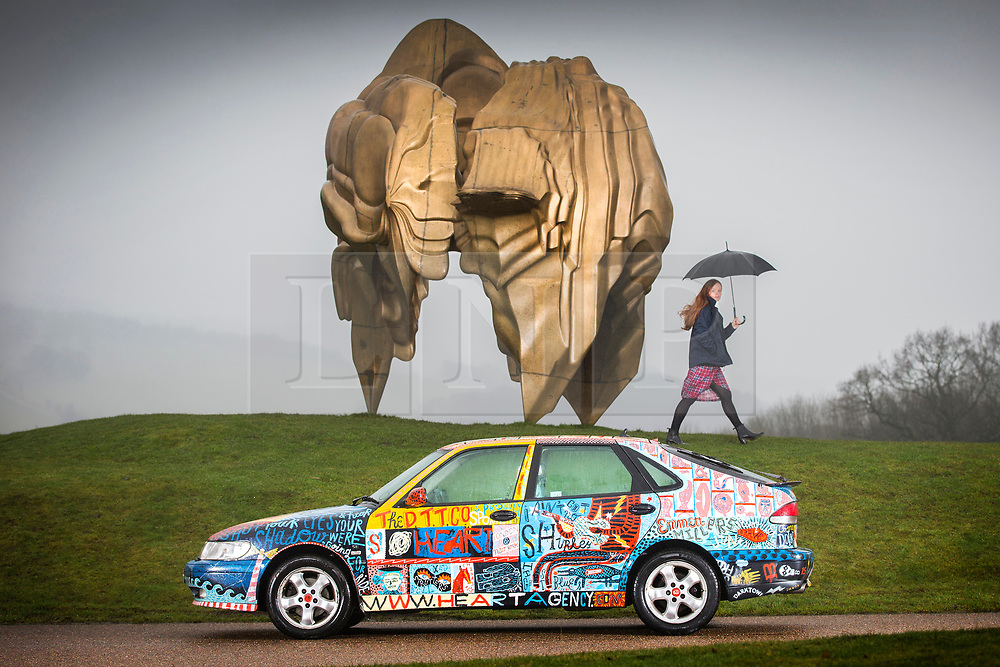 © Licensed to London News Pictures. 19/02/2018. Wakefield UK. Picture shows Helen Tulloch looking at the Darktown Turbo Taxi at Yorkshire Sculpture Park this morning.  Darktown Turbo Taxi is by artist Jonny Hannah, the Saab 9-3 was customised by Hannah in his studio & acts as a mobile advert for the emporiums & establishments that can be found in Darktown, a mythical hinterland created by the artist as a response to the lack of individuality on the modern uk high street. Photo credit: Andrew McCaren/LNP