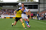 Burton Albion defender Tom Naylor (15) battles for the ball with Sheffield Wednesday midfielder Adam Reach (20) during the EFL Sky Bet Championship match between Burton Albion and Sheffield Wednesday at the Pirelli Stadium, Burton upon Trent, England on 26 August 2017. Photo by Richard Holmes.