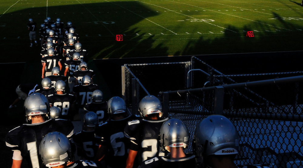 (staff photo by Matt Roth)..After their pre-game pep talk, Manchester Valley's varsity football team takes the field before the school's first-ever football game against the Clear Spring Blazers Friday, September 4, 2009. The Mavericks lost 6-28.