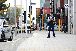 March 17, 2019 - Christchurch, New Zealand - A police officer stands guard outside the Christchurch District Court where the suspected shooter appeared in Christchurch on March 16, 2019. At least 49 people have died in the Christchurch mosque shooting, the worst terror attack in New Zealand history. The national security threat level has been increased from low to high for the first time in New Zealand's history after this attack. (Credit Image: © Sanka Vidanagama/NurPhoto via ZUMA Press)