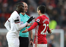 Watford's M'Baye Niang (left) and Manchester United's Ander Herrera are lectured by referee Robert Madley