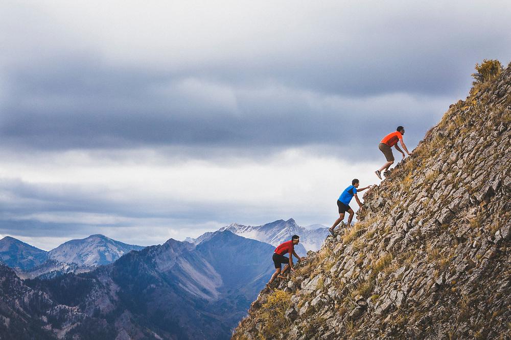 Andy Dorais, Jason Dorais, and Noah Howell scrambling toward Mount Raymond, Wasatch Range, Utah.