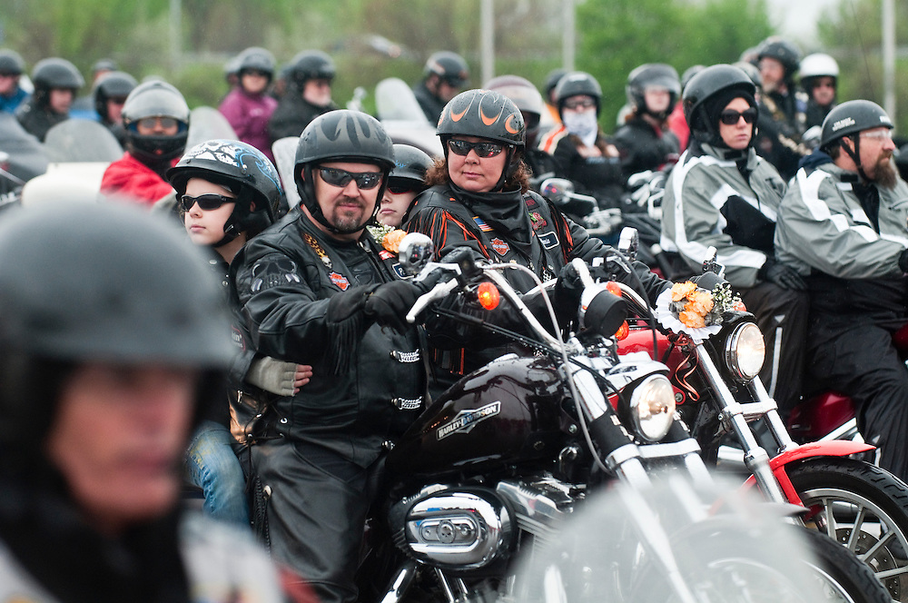 Matt Dixon   The Flint Journal..Pat and Kim Perge of Montrose prepare to ride the 11th annual Bikin' for Burns fundraiser at the Perani Arena in Flint Saturday. The two were married moments earlier by Pastor Brian McKay of the Victory Biker Church in Lennon. The area event is sponsored by American Bikers Aiming Toward Education (ABATE) of Michigan Region 20 as they seek to promote motorcycle safety while raise funds for fire prevention. This year's recipients will be the Swartz Creek and Durand Fire Departments.