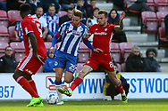 Joe Ralls of Cardiff City (r) looks to tackle Nick Powell of Wigan Athletic. EFL Skybet Championship match , Wigan Athletic v Cardiff city at the DW Stadium in Wigan, Lancs on Saturday 22nd April 2017.<br /> pic by Chris Stading, Andrew Orchard sports photography.