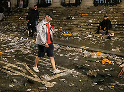 © Licensed to London News Pictures. 11/07/2021. London, UK. A supporter walks home through litter strewn streets near Trafalgar Square, central London after England lost to Italy in the EURO 2020 final. Photo credit: Peter Macdiarmid/LNP