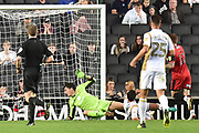 Grimsby Town striker Jordan Cook (11) scores a goal from open play 0-1 during the EFL Sky Bet League 2 match between Milton Keynes Dons and Grimsby Town FC at stadium:mk, Milton Keynes, England on 21 August 2018.