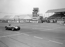 File photo dated 14-07-1956 of Argentinian Juan-Manuel Fangio roars down the front straight in his Ferrari during the RAC British Grand Prix at Silverstone on his way to victory. The race was run over 101 laps, a distance of 303 miles