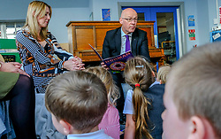 Pictured: Teacher Lisa Black and John Swinney take the lead in story telling and singing songs<br /><br />John Swinney headed to Hermitage Park Primary School today to read his favourite bedtime story to pupils to promote the school's 'coorie in' project, an online channel that shares bedtime stories and promotes literacy.<br /><br /> Ger Harley | EEm 14 May 2019