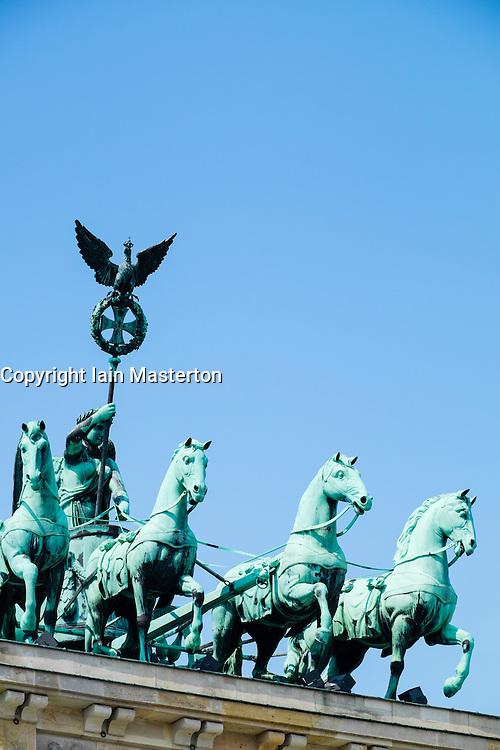 Detail of Quadriga statues on top of Brandenburg Gate in Berlin Germany