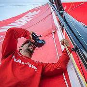 Leg 4, Melbourne to Hong Kong, day 07 on board MAPFRE, Guillermo Altadill looking at dongfeng with the binoculars. Photo by Ugo Fonolla/Volvo Ocean Race. 08 January, 2018.