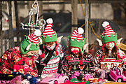 """05 DECEMBER 2020 - INDIANOLA, IOWA: Children dressed as Christmas elves work on toys in """"Santa's Workshop"""" during a drive through visit with Santa Claus. About 500 children visited Santa Claus and Mrs. Claus in Indianola Saturday. The town has hosted Santa on the town square for the last seven years but the COVID-19 (SARS-Cov-2) pandemic forced organizers to move the event to the parking lot of a local hardware store and do it """"drive through"""" style. Iowa has one of the highest Coronavirus test rates in the United States.        PHOTO BY JACK KURTZ"""