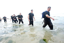 Avi Mayol, the Chairman of the International Krav Maga Federation (IKMF), takes students through Military in Different Environments, with training taking place on a beach near Netanya. Day seven on the Train & Travel in Israel, on Thursday 6th Jan 2011. Train & Travel is a unique ten day program designed for IKMF's instructors, students & guests, interested in combining Krav Maga training with a tour of the holy land.  ©2011 Michael Schofield. All Rights Reserved.