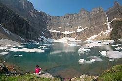 Hiker at Iceberg Lake, Glacier National Park, Montana, US
