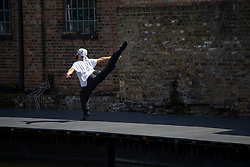 © Licensed to London News Pictures.<br /> 12/07/2020. London, UK. A group DistDancing showcasing ballet and contemporary dance at Hoxton Docks, north London. The group was created during the lockdown as a platform for open air live performances; an initiative started by Royal Ballet dancers Chisato Katsura and Valentino Zucchetti in collaboration with Hoxton Docks. Photo credit: Marcin Nowak/LNP