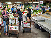 03 AUGUST 2019 - ST. PAUL, MINNESOTA: The farmers' market in the Hmong Village shopping center. Thousands of Hmong people, originally from the mountains of central Laos, settled in the Twin Cities in the late 1970s and early 1980s. Most were refugees displaced by the American war in Southeast Asia. According to the 2010 U.S. Census, there are now 66,000 ethnic Hmong in the Minneapolis-St. Paul area, making it the largest urban Hmong population in the world. There are two large Hmong markers in St. Paul. The Hmongtown Marketplace has are more than 125 shops, 11 restaurants, and a farmers' market in the summer. Hmong Village is newer and has more than 250 shops and 17 restaurants.   PHOTO BY JACK KURTZ