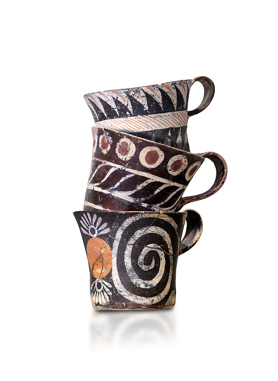 """Minoan Kamares """"eggshell"""" ware cups with  with  polychrome decorations, from set found at Phaistos Palace 1800-1600 BC; Heraklion Archaeological  Museum, white background.<br /> <br /> These cups found as parts of sets in Phaistos palace were names """"eggshell"""" ware due to the very thin walls of the cups. This style of pottery is named afetr Kamares cave where this style of pottery was first found .<br /> <br /> If you prefer to buy from our ALAMY PHOTO LIBRARY  Collection visit : https://www.alamy.com/portfolio/paul-williams-funkystock/minoan-art-artefacts.html . Type -   Heraklion   - into the LOWER SEARCH WITHIN GALLERY box. Refine search by adding background colour, place, museum etc<br /> <br /> Visit our MINOAN ART PHOTO COLLECTIONS for more photos to download  as wall art prints https://funkystock.photoshelter.com/gallery-collection/Ancient-Minoans-Art-Artefacts-Antiquities-Historic-Places-Pictures-Images-of/C0000ricT2SU_M9w"""