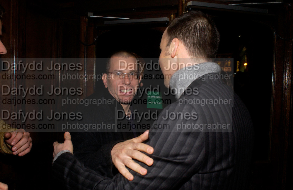 Jonathan Newhouse and David Furnish, Party hosted by Isabella Blow in honour of Shaun Leane to celebrate his jewelry collection. Liberty's. London. 8 December 2004. ONE TIME USE ONLY - DO NOT ARCHIVE  © Copyright Photograph by Dafydd Jones 66 Stockwell Park Rd. London SW9 0DA Tel 020 7733 0108 www.dafjones.com