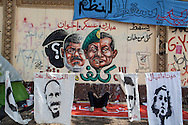 Anti-Morsi graffiti on the walls surrounding the presidential palace in Cairo.