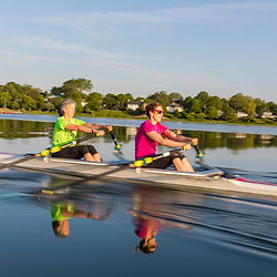Two women from the Portland Community Rowing Association row in Back Cove in Portland, Maine.