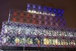 © Licensed to London News Pictures. 21/11/2016. Birmingham, UK. A service of prayer to mark the deaths of 21 people killed in the Birmingham Pub bombings on the 42nd anniversary. Birmingham Central Library was lit for the evening in tribute. credit: Dave Warren/LNP