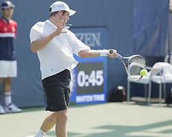August 22, 2017 - New York, New York, United States - Bradley Klahn of USA returns ball during qualifying game against Marc Polmans of Australia at US Open 2017 (Credit Image: © Lev Radin/Pacific Press via ZUMA Wire)
