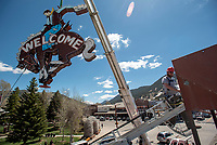 """The """"bucking bronco"""" neon sign is maneuvered into place at the top of the Cowboy Bar on Tuesday. The sign returned to Jackson after several weeks in Boise, Idaho, for restoration."""