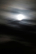 full moon at night with moving clouds