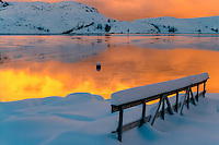 Norway, Stoksund. Winter colours. An ice and snow covered landscape at sunset.