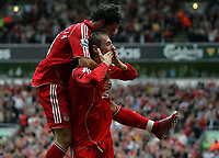 Photo: Paul Thomas.<br /> Liverpool v West Ham United. The Barclays Premiership. 26/08/2006.<br /> <br /> Peter Crouch (R) celebrates his goal for Liverpool with Luis Garcia.