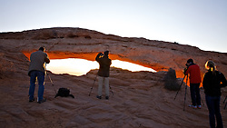 Photographers gather around Mesa  Arch in Canyonlands National Park to  capture the magic of its legendary glow.