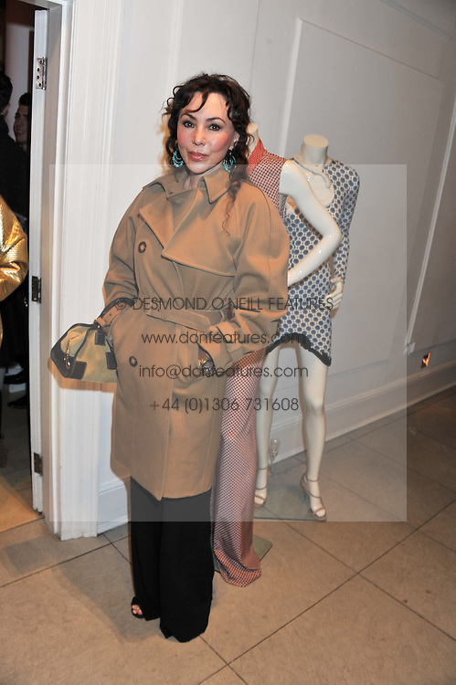 MARIE HELVIN at a party to celebrate the switching on of the Christmas Lights at the Stella McCartney store, Bruton Street, London on 29th November 2011.