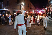 Residents dressed in peasant farmer costumes carry torches through the streets to re-enact the arrival of Ignacio Allende during the Mexican Revolution on the 251st birthday of the Mexican hero January 20, 2020 in San Miguel de Allende, Guanajuato, Mexico.