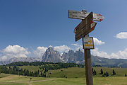 Hiking trails signposts on the Siusi plateau, above the South Tyrolean town of Ortisei-Sankt Ulrich in the Dolomites, Italy.